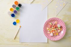 Party management and organization concept with sweets, confetti and blank pages. Creative celebration flat lay with copy space royalty free stock images