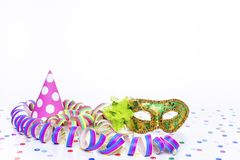 Party mask with party hat. And confetti Stock Images