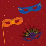 Party Masks. Masquerade masks on red background with streamers and confetti Royalty Free Stock Photos