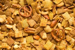 Party Mix Background. Close Up of cereal, pretzel, and nut snack mix background Stock Photo