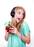 Party music. Girl listening to party music from a drink Stock Image