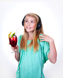 Party music. Girl listening to party music from a drink Royalty Free Stock Images