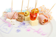 Party nibbles with streamers Royalty Free Stock Photo