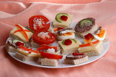 party nibbles on a white plate Stock Images