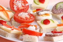 party nibbles on a white plate Stock Image