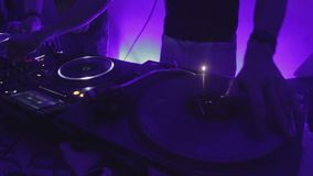 Party in night club, skilled DJ scratching vinyl record, entertaining clubbers. Stock footage stock video