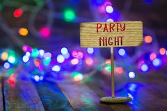 Party night on small sign board stock photography