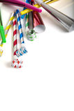 Party Noise Makers on white. A group of colorful party noise makers, including horns etc. , on a white background with copy space royalty free stock image