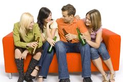 Party on the orange couch stock image