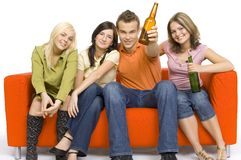 Party on the orange couch Royalty Free Stock Images