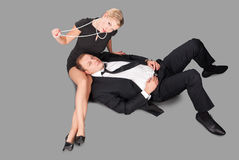 The party is over. Glamour caucasian man and women lies on a floor resting after party Royalty Free Stock Photos