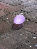After party is over. A shining balloon after the party Royalty Free Stock Image