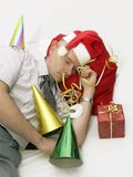 When the party is over. Man in santa claus cap sleeping hard after new year's eve celebration Stock Image