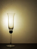 Party over, empty champagne flute. Retro feel, regret etc Royalty Free Stock Images
