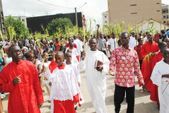 PARTY PALM THE CATHOLIC CHURCH. Picture African Christian Catholic priests with all branches in their hands walking to celebrate the feast of boughs stock images
