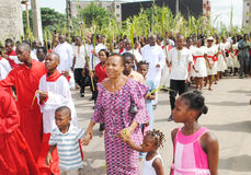 PARTY PALM THE CATHOLIC CHURCH. Picture African Christian Catholic priests with all branches in their hands walking to celebrate the feast of boughs stock photos