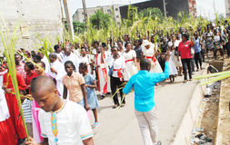 PARTY PALM THE CATHOLIC CHURCH. Picture African Christian Catholic priests with all branches in their hands walking to celebrate the feast of boughs stock photo