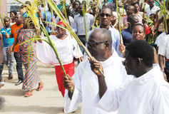 PARTY PALM THE CATHOLIC CHURCH. Picture African Christian Catholic priests with all branches in their hands walking to celebrate the feast of boughs royalty free stock photos