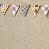 Party paper flags garland  on beige fabric background Stock Photography