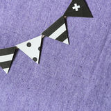 Party paper flags garland  on fabric background Stock Image