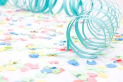 Party paper ribbons and confetti Stock Photo