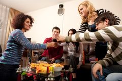 Party people. Having some drinks together, celebrating, having fun Stock Images