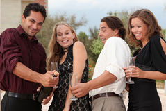 Party people. Opening champagne bottle Stock Photo