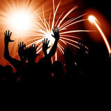 Party people. Some party people with a fireworks background Royalty Free Stock Photography