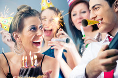 Party people in bar celebrating birthday Stock Photography
