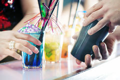 Party people in bar with cocktails Stock Photography