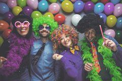 Party People celebrating carnival or New Year in party club.  stock images