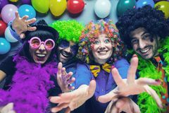 Party People celebrating carnival or New Year in party club.  stock photos