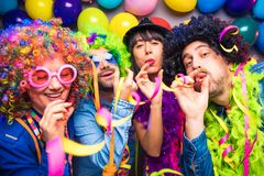 Party People celebrating carnival or New Year in party club stock photography