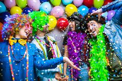 Party People celebrating carnival or New Year in party club stock photos