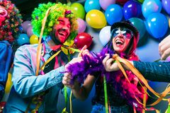 Party People celebrating carnival or New Year in party club royalty free stock photography