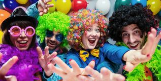 Party People celebrating carnival or New Year in party club.  royalty free stock photo