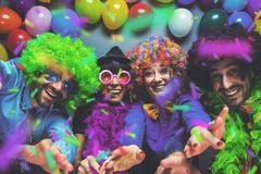 Party People celebrating carnival or New Year in party club.  royalty free stock image