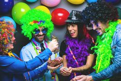 Party People celebrating carnival or New Year in party club stock image