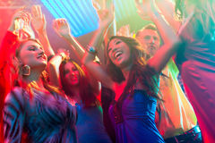 Party people dancing in disco or club. Group of party people - men and women - dancing in a disco club to the music Royalty Free Stock Image