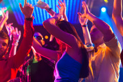 Party people dancing in disco or club. Group of party people - men and women - dancing in a disco club to the music Royalty Free Stock Photography