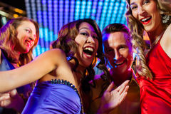 Party people dancing in disco or club Stock Photography