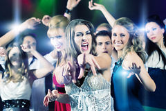 Party people dancing in disco club. Young people dancing in club or disco party, the girls and boys, friends, having fun royalty free stock photo