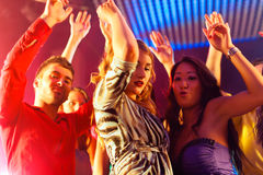 Party people dancing in disco or club Stock Images