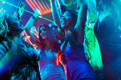 Party people dancing in disco or club Stock Photos