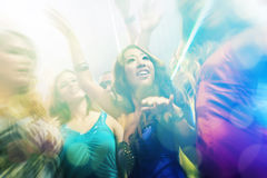 Party people dancing in disco or club. Group of party people - men and women - dancing in a disco club to the music Royalty Free Stock Photo