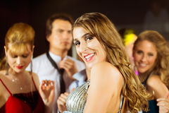 Party people dancing in disco club. Young people dancing in club or disco and have party; the girls and boys, friends, having fun royalty free stock images