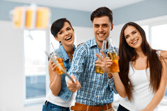 Party People. Friends Making Photo With Smartphone Selfie-stick. Stock Photography