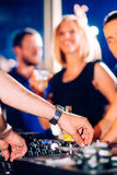 Party people in front of turntable Royalty Free Stock Images