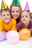 Party people with hats and balloons Stock Photo