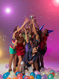Party people reaching for a disco ball Royalty Free Stock Images